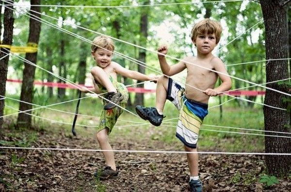 Tie rope between trees to create a fun obstacle course for kids