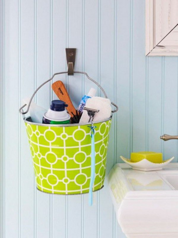 Colorful metal buckets hanging on the wall would be cute in a kids' bathroom