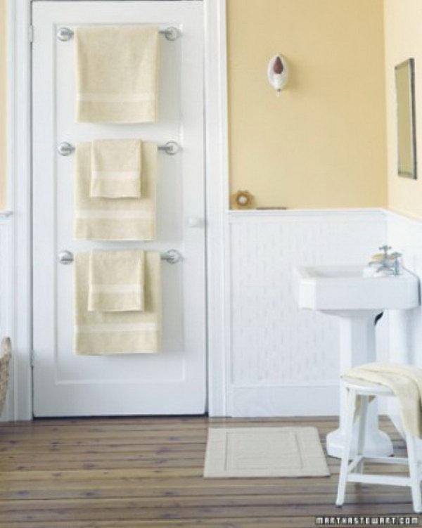 Hang Towel Holders Behind Bathroom Door For More Storage Space