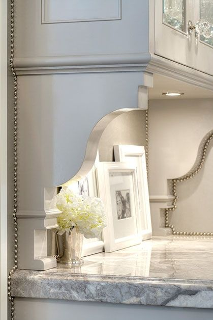Create a Custome Look By Adding Brackets and Nailhead Trim under Plain Cabinets