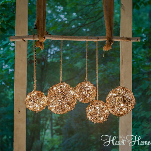 Easy DIY Outdoor Chandelier Made from Grapevine Balls. Check out the tutorial