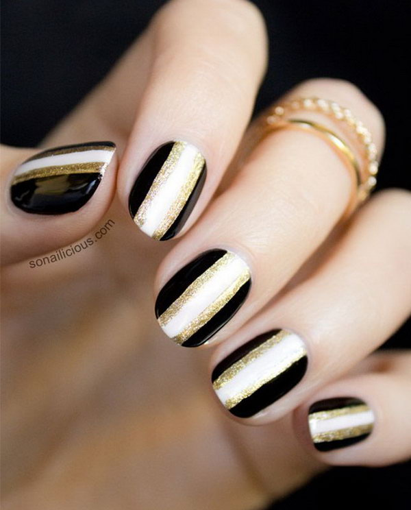 Sparkly Black & White Nails with a Touch of Gold.