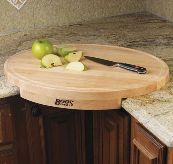 John Boos Corner Cutting Board. This oval shaped maple wood cutting board converts a counter corner space into efficient working space. Get it at