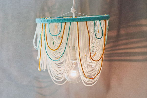 Yarn Chandelier. Check out the tutorial