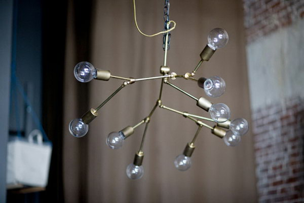 Brass Orbit Chandelier.