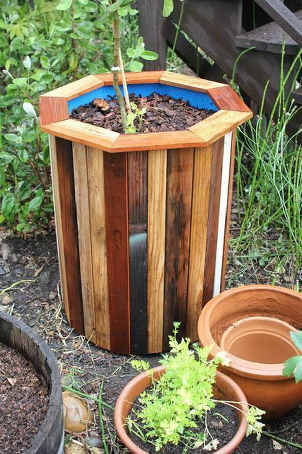 DIY 55 Gallon Plastic Barrel Planter. Check out the details