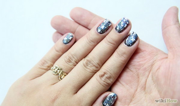 DIY Galaxy Nail Art. Get the tutorial