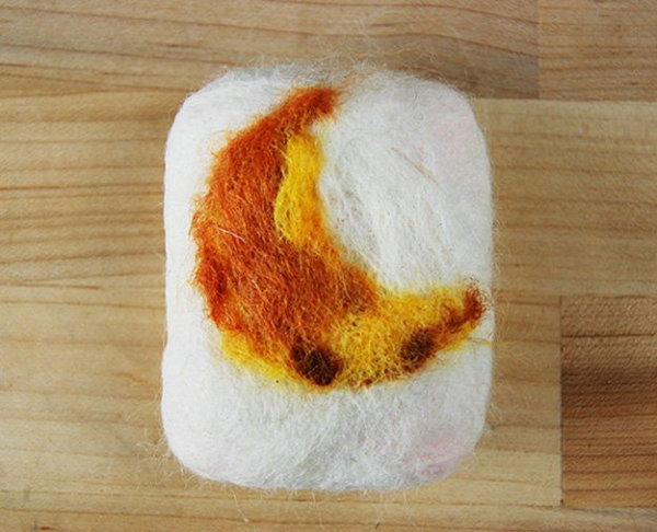 DIY Felted Soap Tutorial. The antibacterial felted soaps covered with wool are exfoliating. You can use simple bar soap and felt it with wool for a unique gift idea.