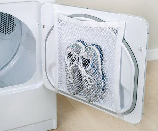 Tape a laundry bag to the inside of your tumble dryer door for easy drying of sports shoes