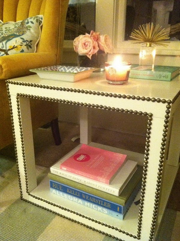 This awesome nailhead trim side table was made with two Lack tables which were assembled to match the form with a solid base.