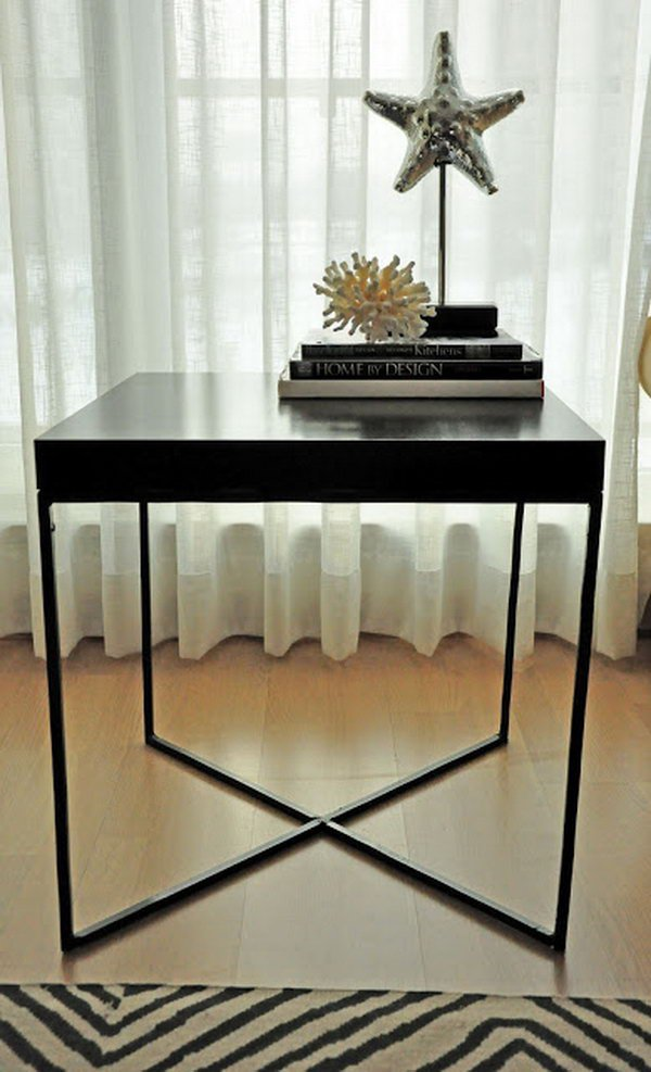 This creative welded table was made with the wood tabletop from an IKEA LACK table and the X shaped metal frame as the table legs.