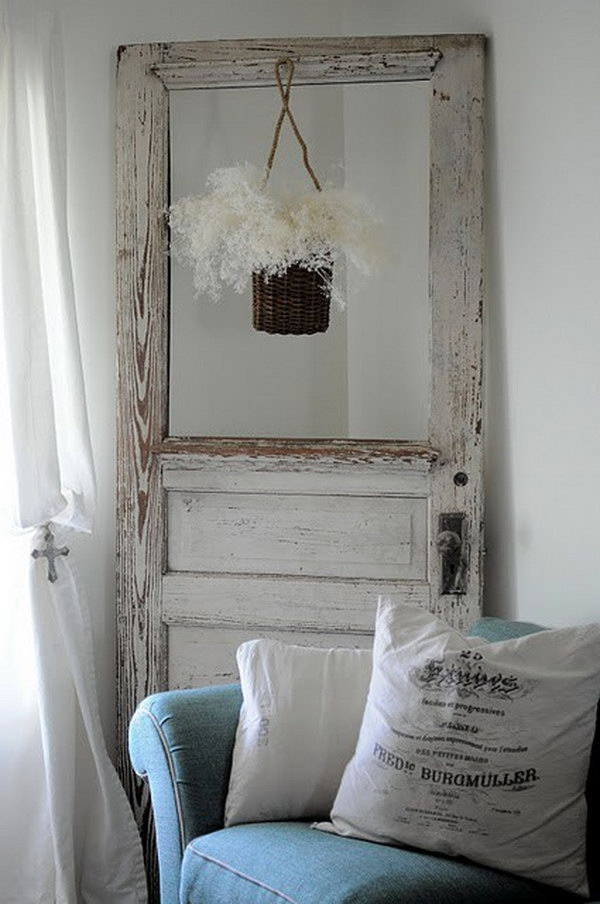 Vintage Door Turned Flower Hanger. I absolutely love it, it looks awesome design.