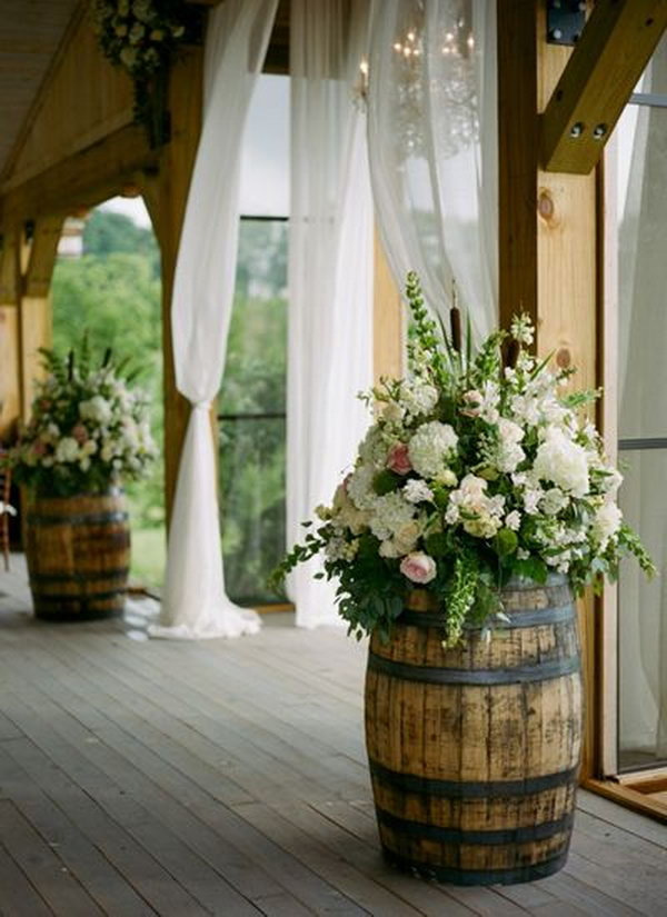 Wine Barrels Decorated With Colorful Flower Bouquets.