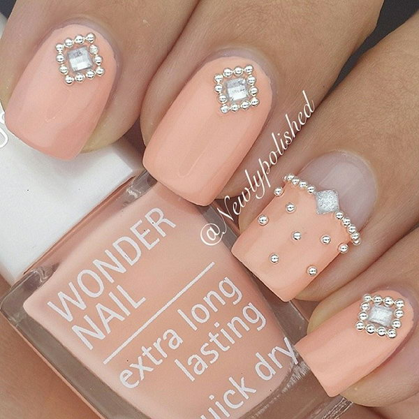 Peach Nails with Little Pearl Crystal.