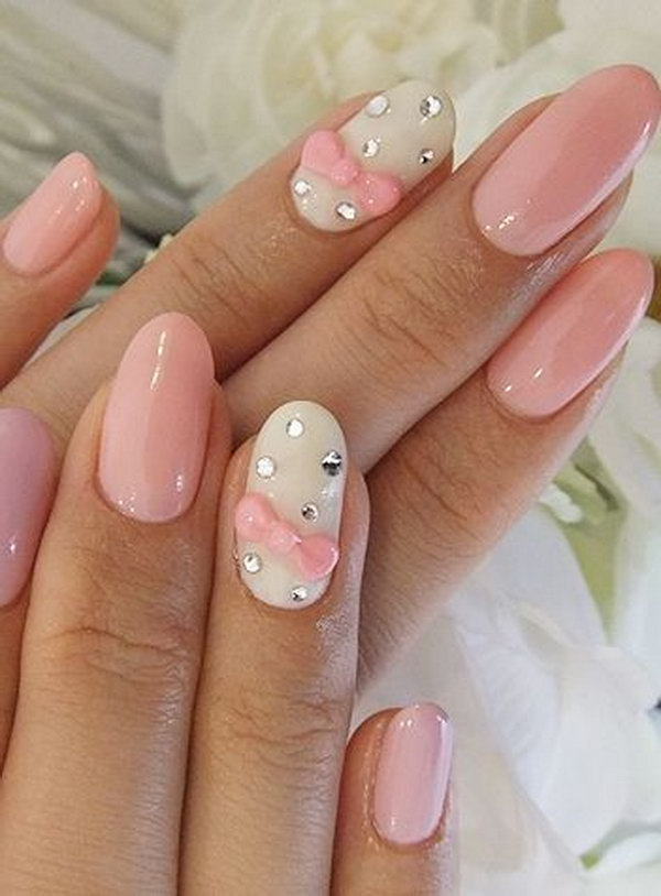 Wedding Nail Design with Pink Bows and Gems.