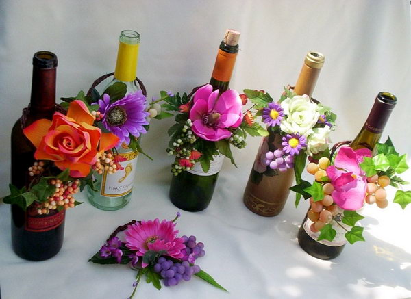 Wine Bottle with Fresh Flowers Wedding Centerpiece.