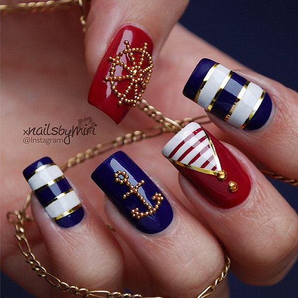 Meticulous Gold Beads Anchor and Wheel Manicure.
