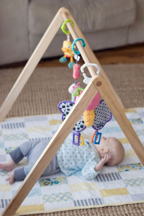 DIY Wooden Baby Gym. Get the tutorial