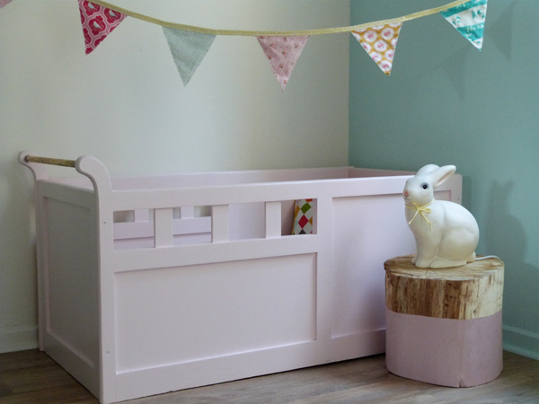DIY Dipped Tree Trunk Table for Baby Room. Get the tutorial