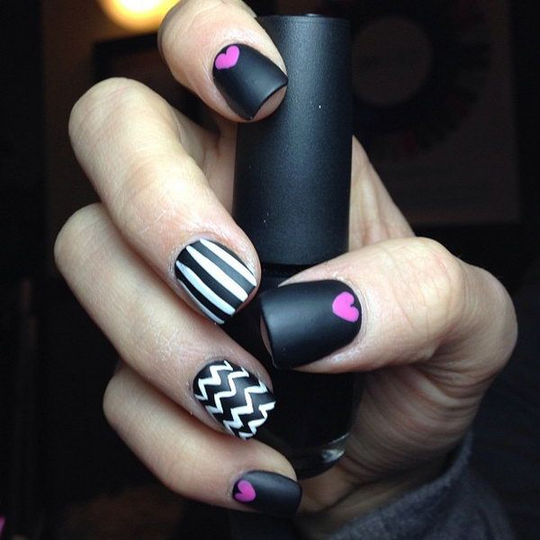 Black and White Chevron Nails Accented with Pink Hearts.