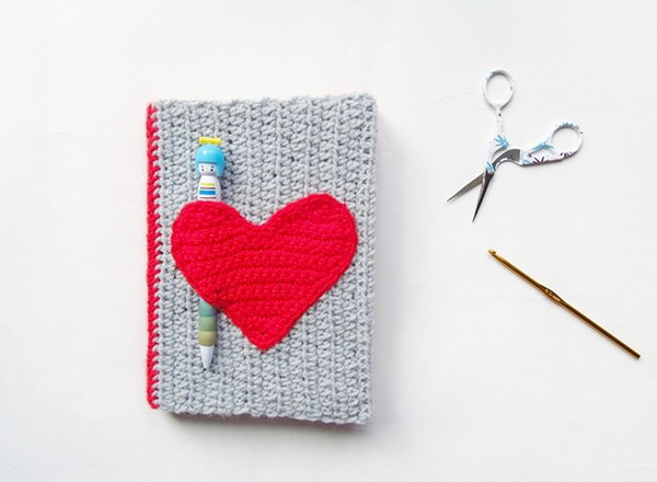 Crochet Notebook Sweater. This crochet notebook sweater looks so cute with a red heart ornament. You can even tuck little things like notes and pens into the heart pocket. So convenient! You can learn how to make it