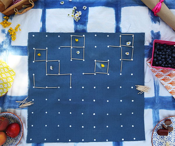 DIY Cloth Picnic Games. You can learn how to make this cloth game board and how to play squares