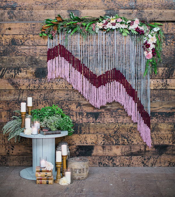 DIY Yarn Backdrop with Floral Accents. This stunning yarn backdrop will transform your great venue into a fantastic venue guaranteed to WOW your guests as they walk in. Love it so much! More pictures via