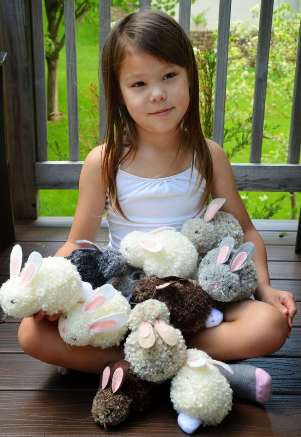 Easy to Make Pom pom Bunnies for Kids. How cute the bunnies are! They are much easier to make than you can imagine even with the kids' hands. Tutorial via