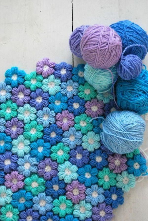 Stunning Crochet Flower Rug. Love your home with this crochet flower rug pattern and make a gorgeously rug that you will love forever. Get the free pattern via