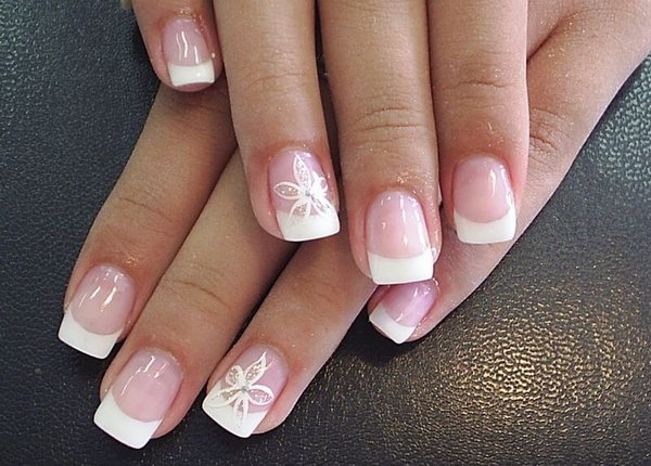 White Tipped French Manicure with Flowers. See the tutorial