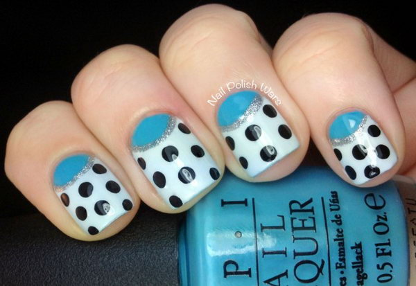Blue Half Moon Nails Accented with Polka Dots. Get the tutorial
