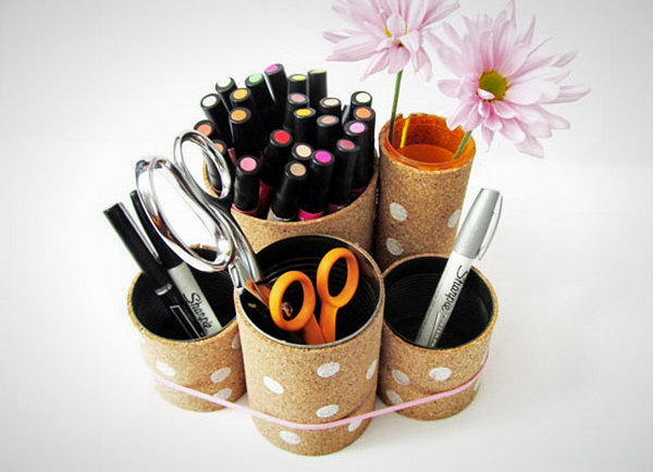 Cork Covered Cans. Wrapping tin cans in something cool, like cork board and adding some colorful accents like a stripe or polka dots. This cork covered cans will double as a decor on your desk. Learn how to make them