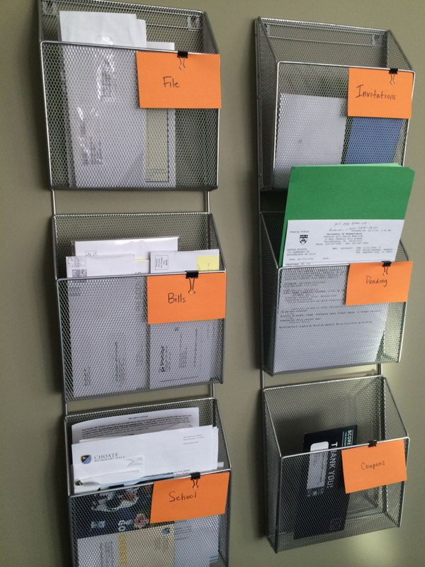 Simple Wall Based Filing System. This simple wall mounted filing system will help you make sure all your bills, school papers, work papers, receipts and all the other dreaded papers are in the right place. See more details