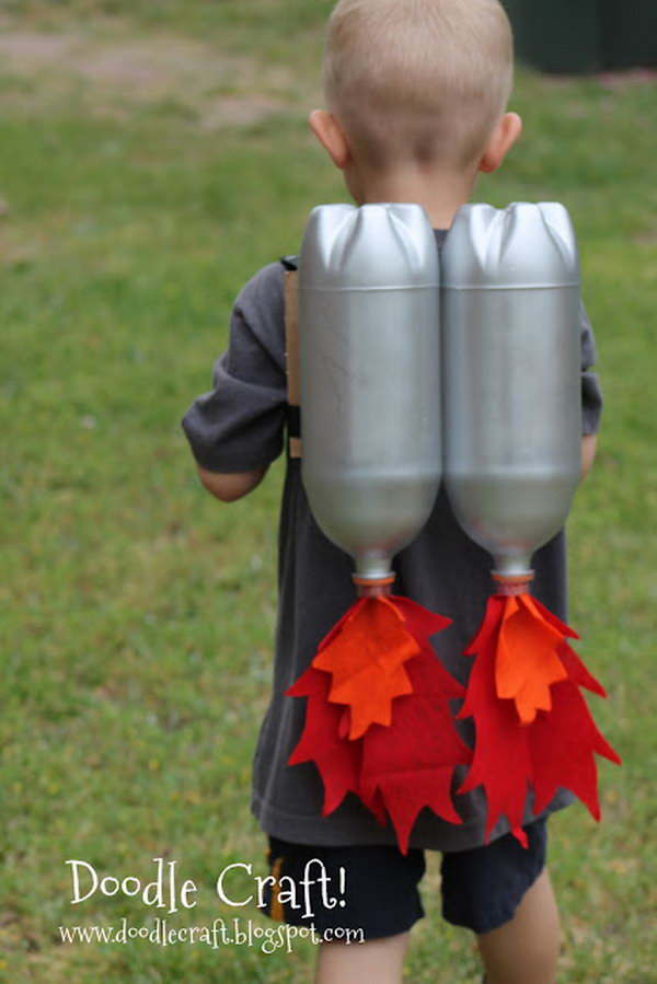 DIY Jet Pack with Soda Bottles. Make a jet pack out of spray painted bottles and red and orange fabric. Great for outerspace play! Tutorial via