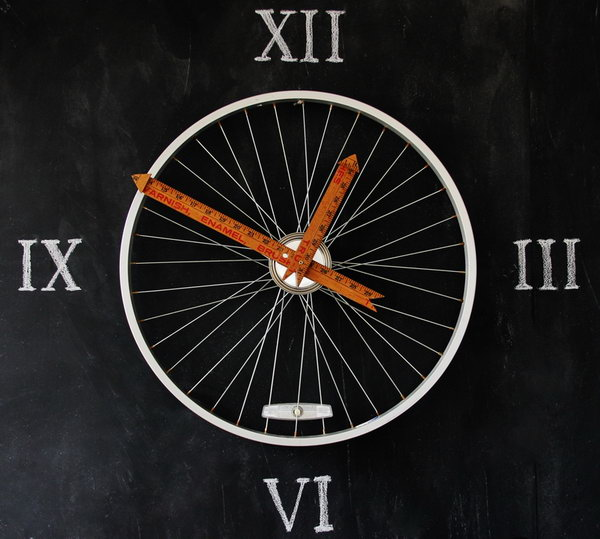 Bicycle Wheel Clock. Yardsticks make the perfect hands on a bicycle wheel clock. It makes a perfect wall art for your home decor. See the tutorial