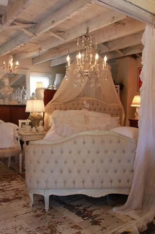 Shabby chic Bed with a Chandelier.