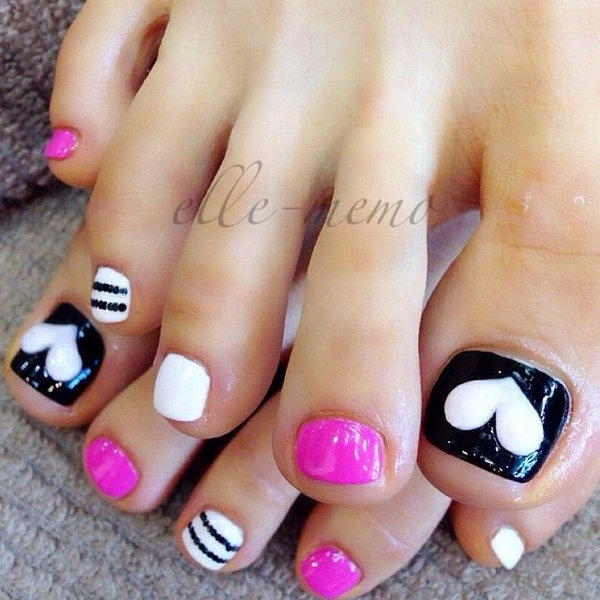 Black and White Toenail Design Accented with Heart and Strips.