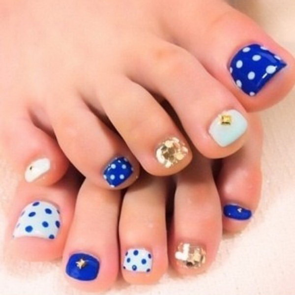 Blue Theme with Polka dots, Glitter and Jewels Toe Nail Design.