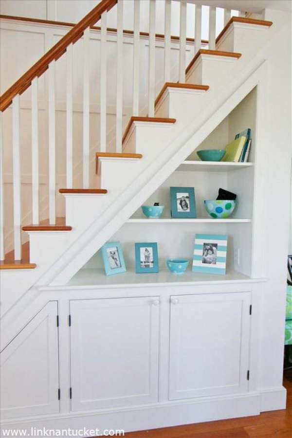 Clever way to mix the shelving and cabinets for more extra storage under the stairs.