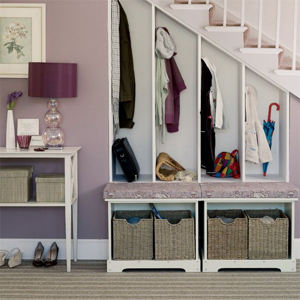 Take advantage of space under stairs to create a mudroom for each family member to hang their coats, umbrella and boots in.