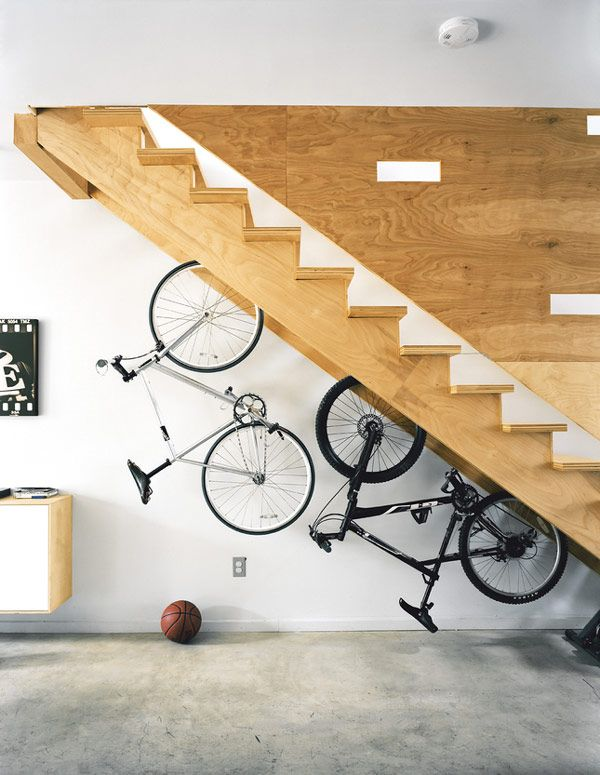 Built in Bicycle Racks in a Staircase. If you are still struggling with where to park the bicycles indoors, you are in the right place. Take advantage of the under stair space with built in racks will help you out.