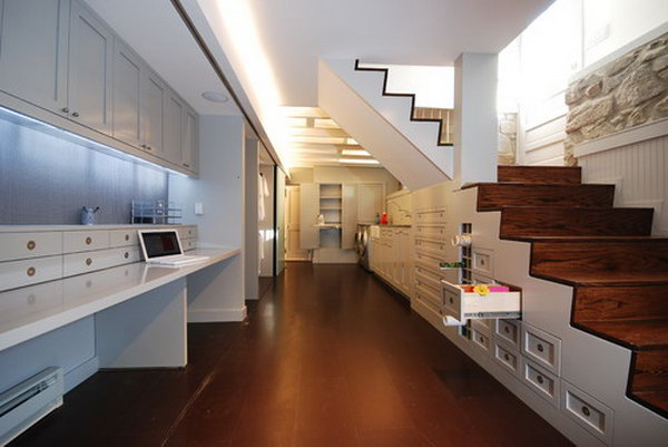 Custom Storage under the Stairs Takes Advantage of a Previously Open and Unused Space.