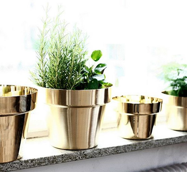 Spray Paint Your Terracotta Pots Metallic Colors to Get an Expensive Look.