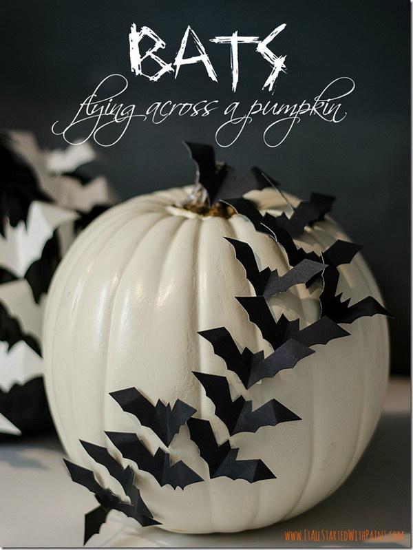 Bats Flying Across A Pumpkin.