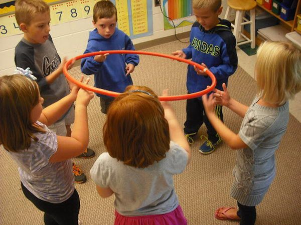 Hula Hoop Team Building Activity. The groups had to move the hula hoop around in a circle until the marker was back where it started with only two fingers each and without dropping it.