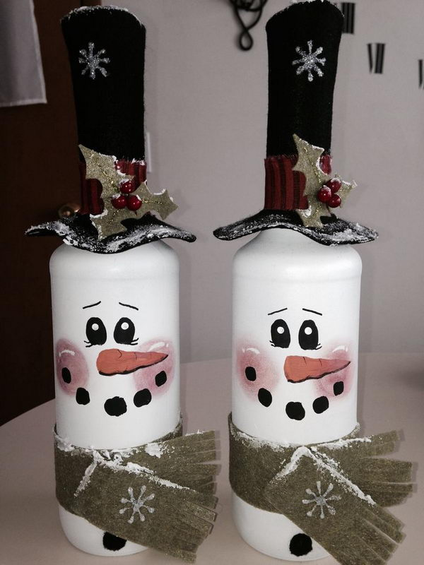 DIY Wine Bottle Lights. Take two empty wine bottles. Spray paint them white. Then draw the faces with paint and dress them up with felt accessories! (Hat comes off to add lights inside bottle.)