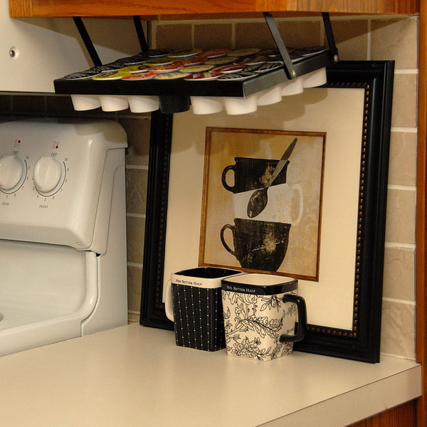 Coffee Keepers Under Cabinet. The rack efficiently uses what is normally wasted space under the cabinet and frees up valuable counter space. No more loose cups on the counter!