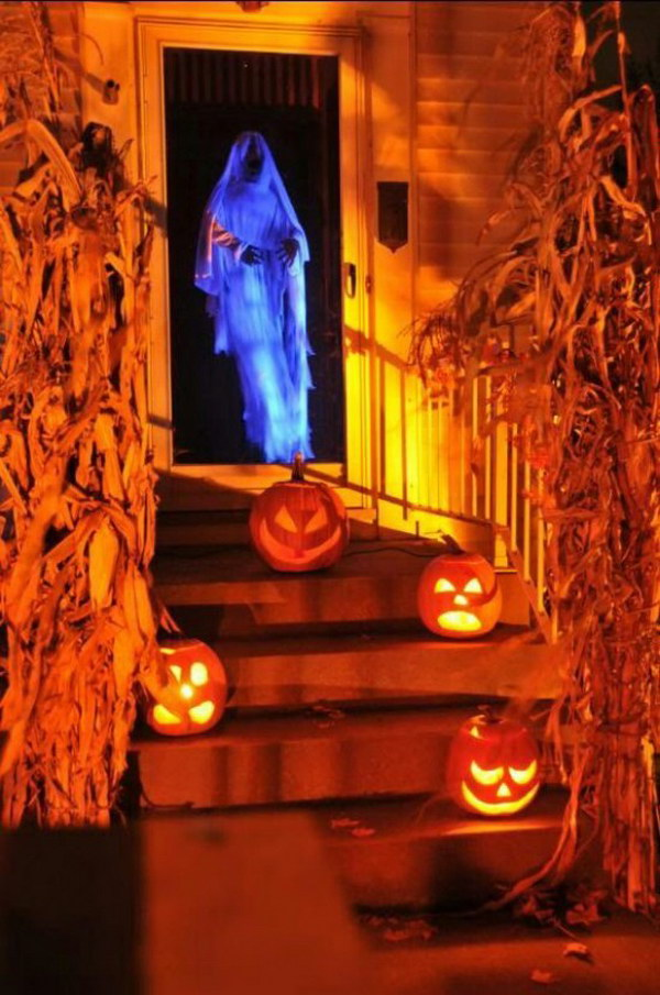 Spooky Door Greeter. What a fun Halloween chicken wire ghost dressed in cheesecloth!
