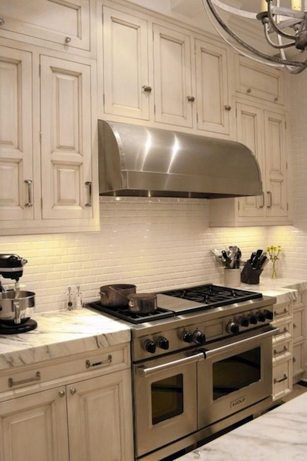 Calacatta Marble Countertops with Ivory Subway Tile Backsplash .