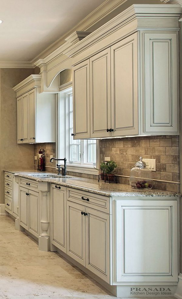 Classic Off White Kitchen With Granite Countertop.